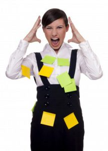 Screaming business women with too much to do
