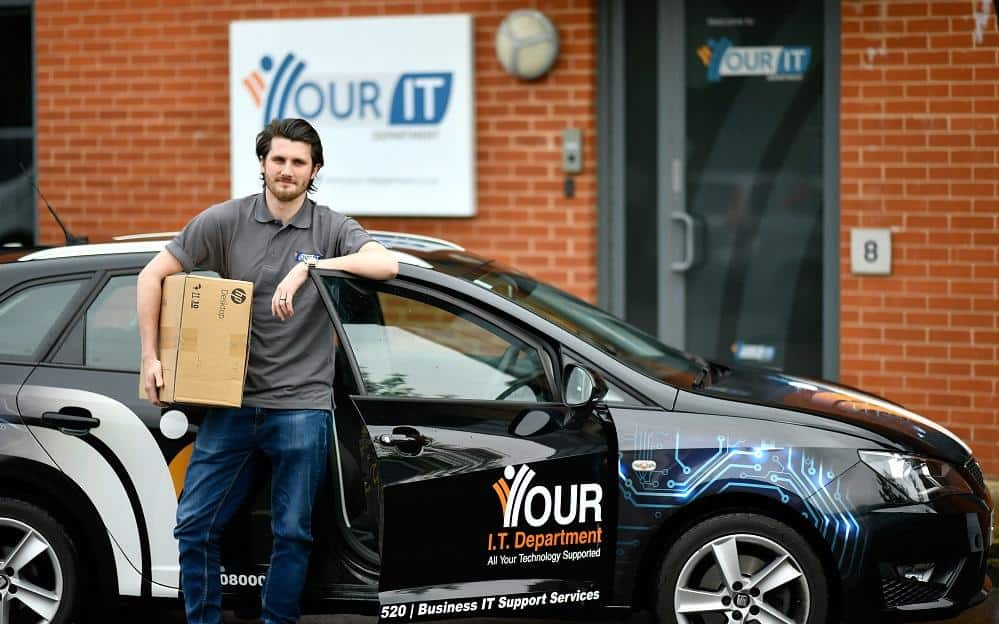 IT Technician with branded car about to deliver IT Support for Recruitment Agency