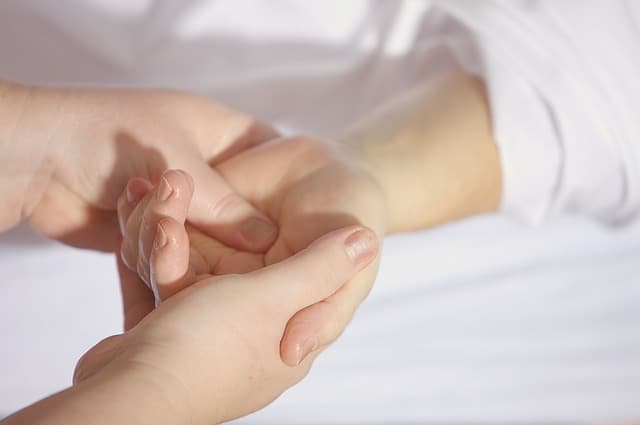 Massaging an injured wrist - Image by andreas160578 from Pixabay