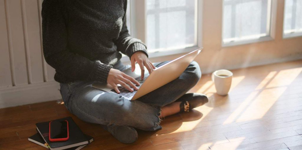 Office 365 lets Small Businesses work from anywhere. Photo by bongkarn thanyakij from Pexels - photo of woman in black sweater and blue denim jeans sittting-